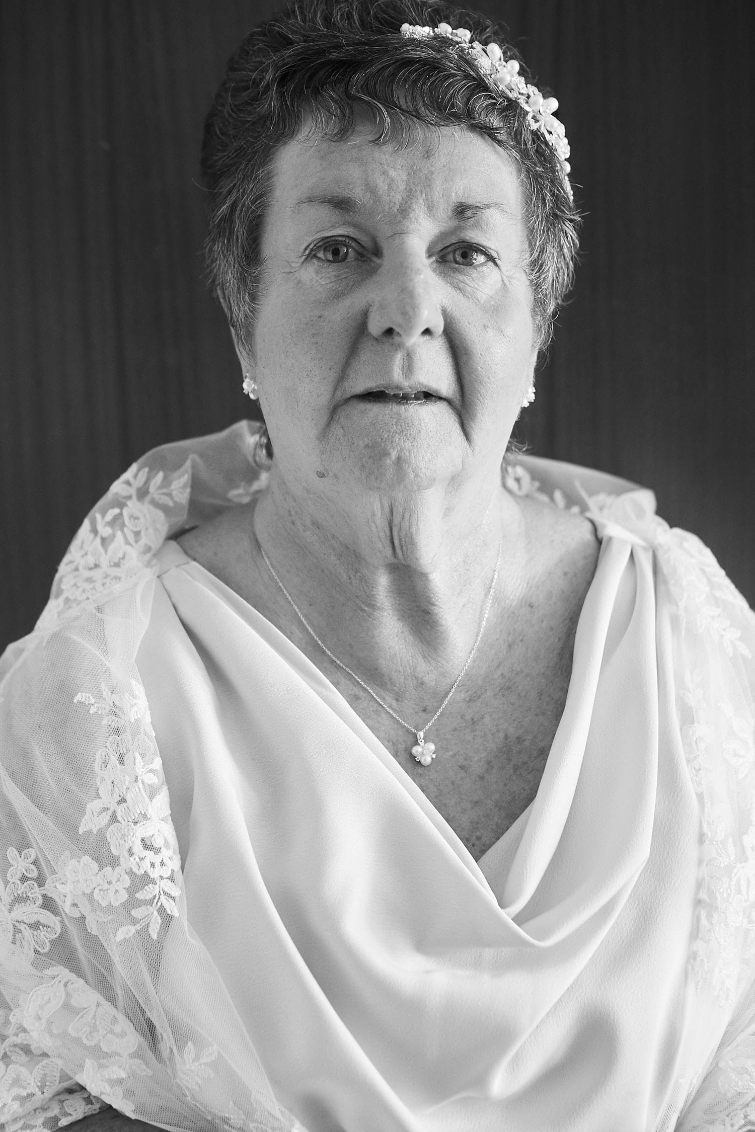 A black and white portrait of an older bride on her wedding day