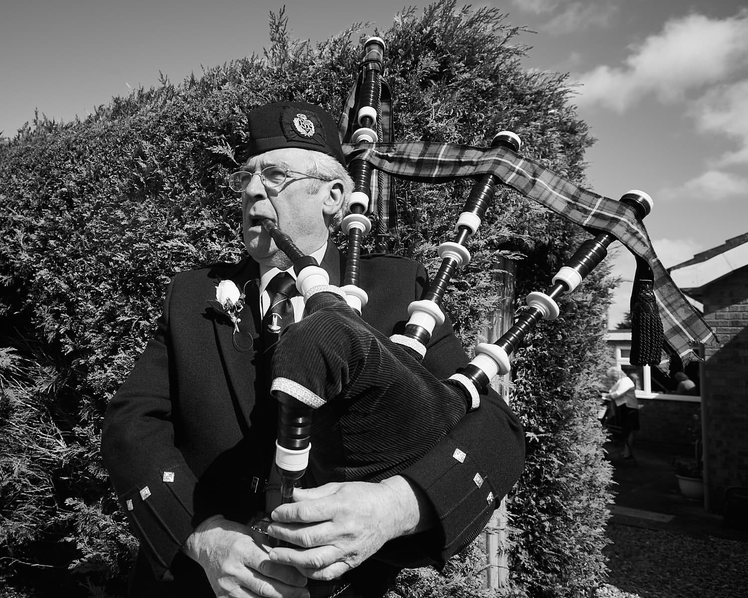 A bagpipe player playing on a wedding day in Lincolnshire