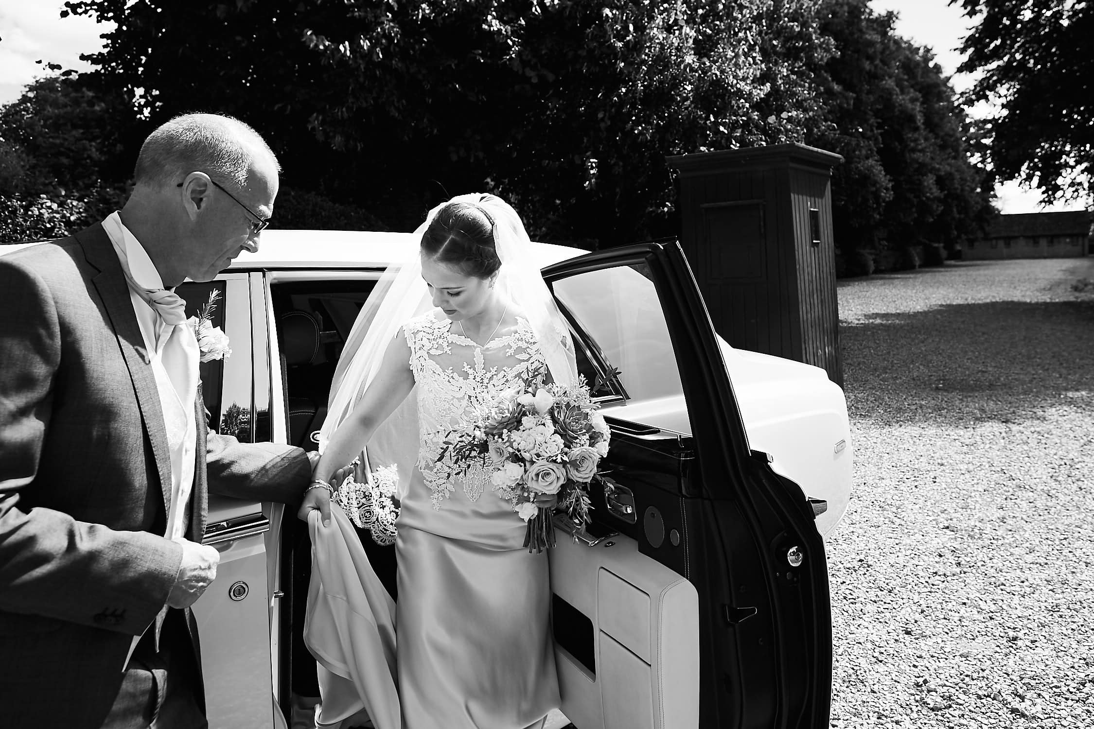Bride leaving car on wedding day arrival
