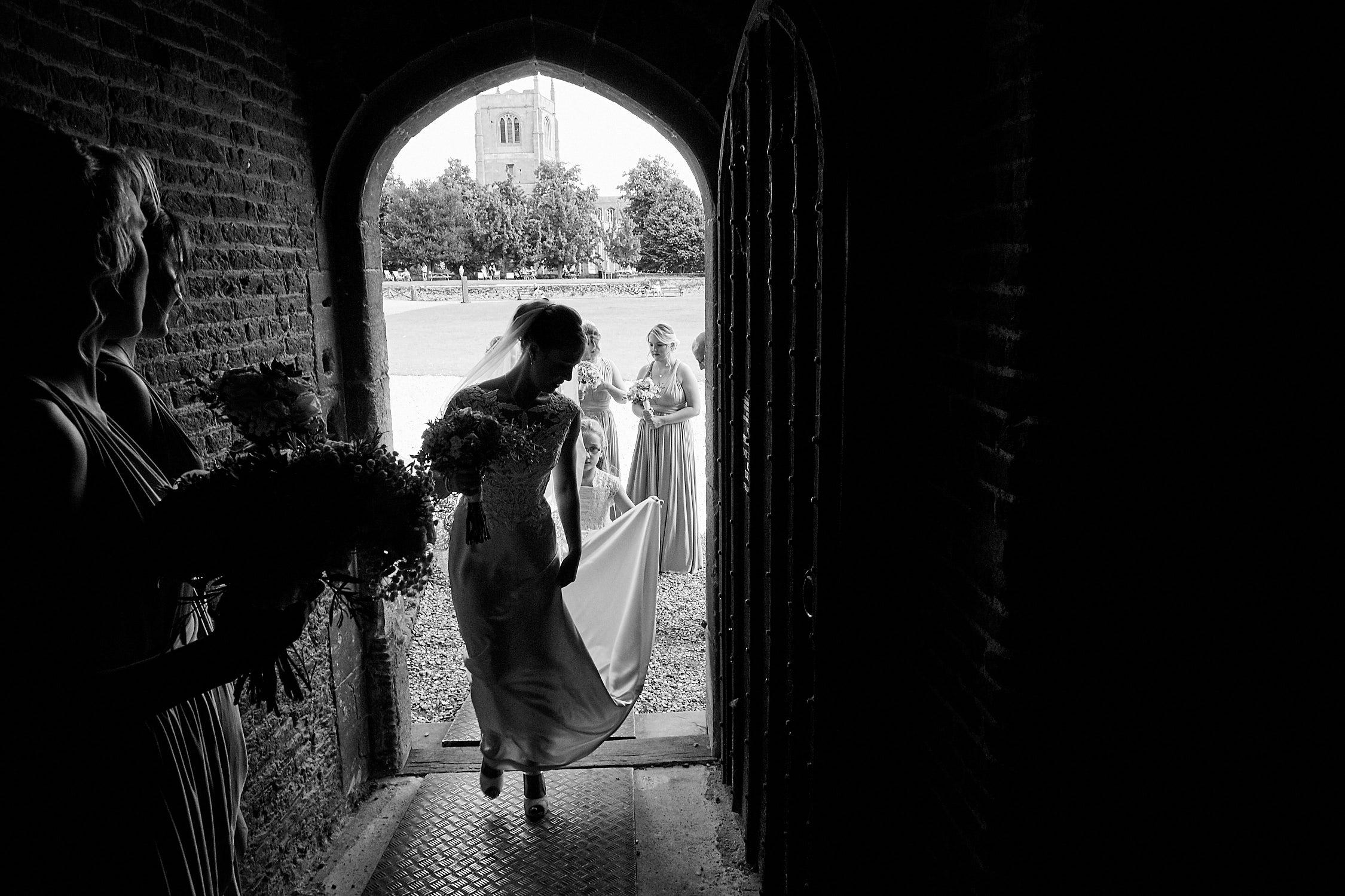 A bride enters Tattershall Castle Wedding Venue