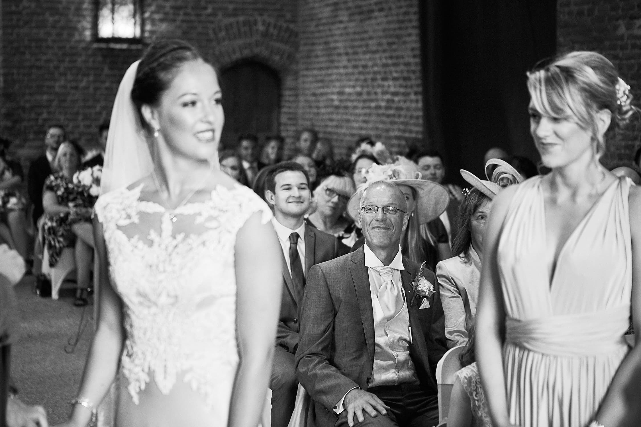 Father smiling at his daughter on wedding day