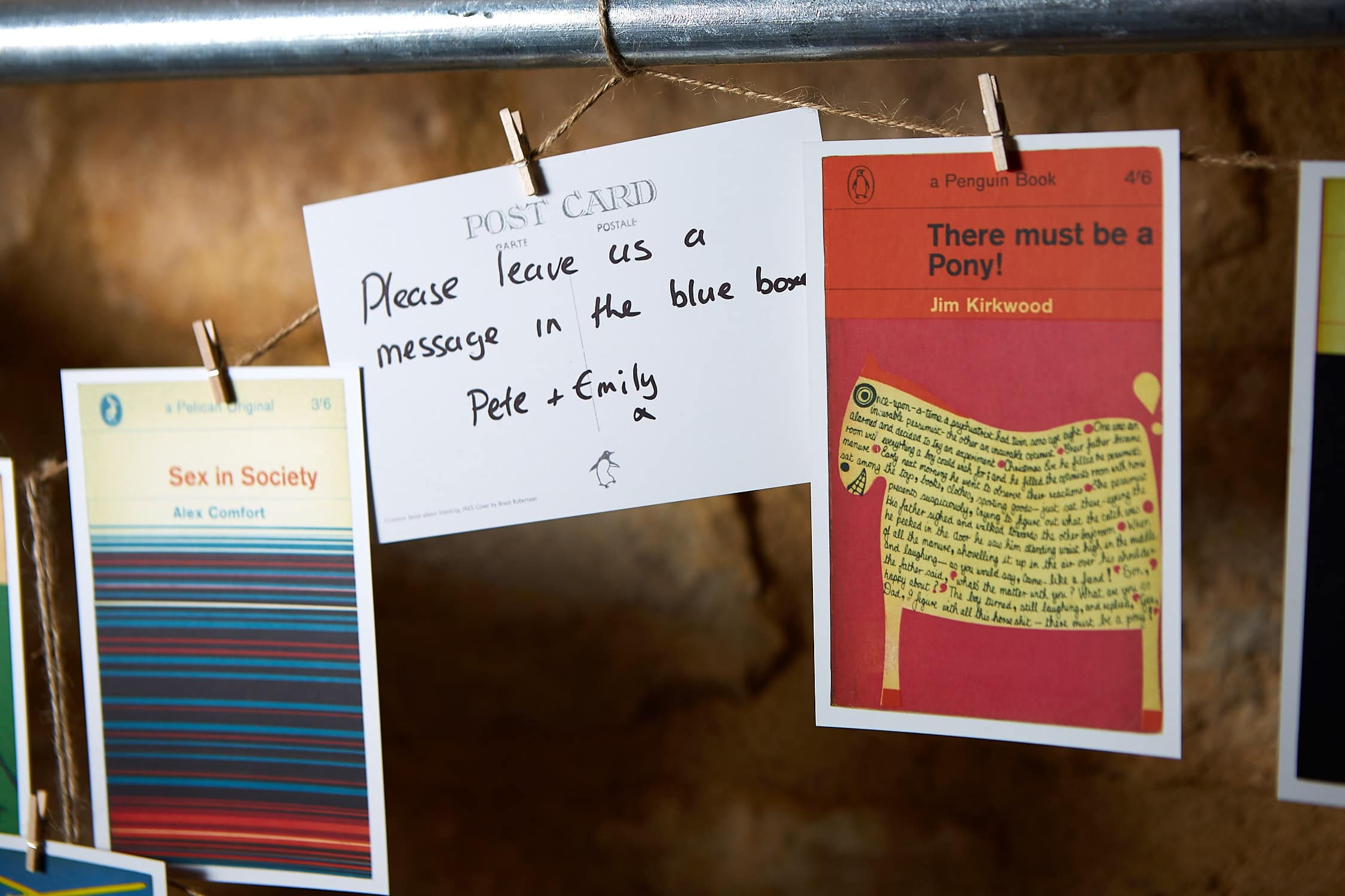A series of Penguin Book postcards hanging on a wire