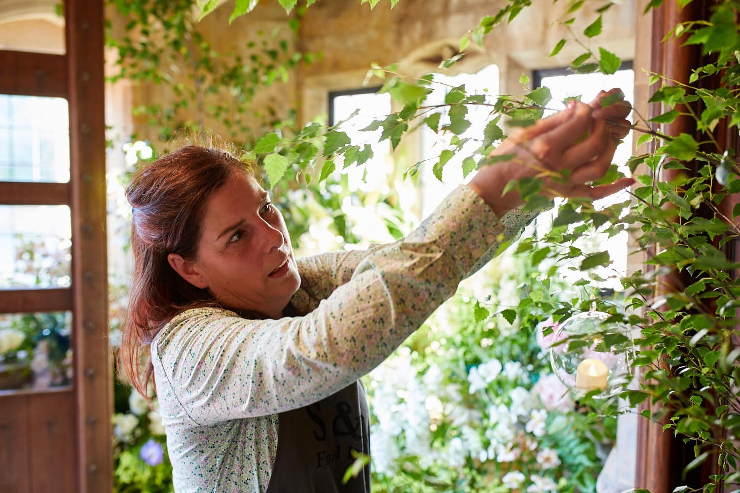 Shirley from S&A Flora Designs working on a flower installation
