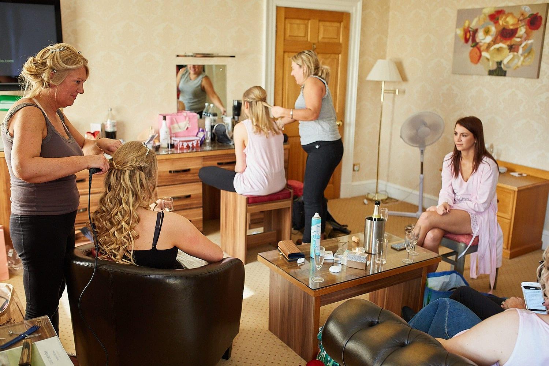 Bridesmaide prepare in the honeymoon suite at Kenwick Park, Louth