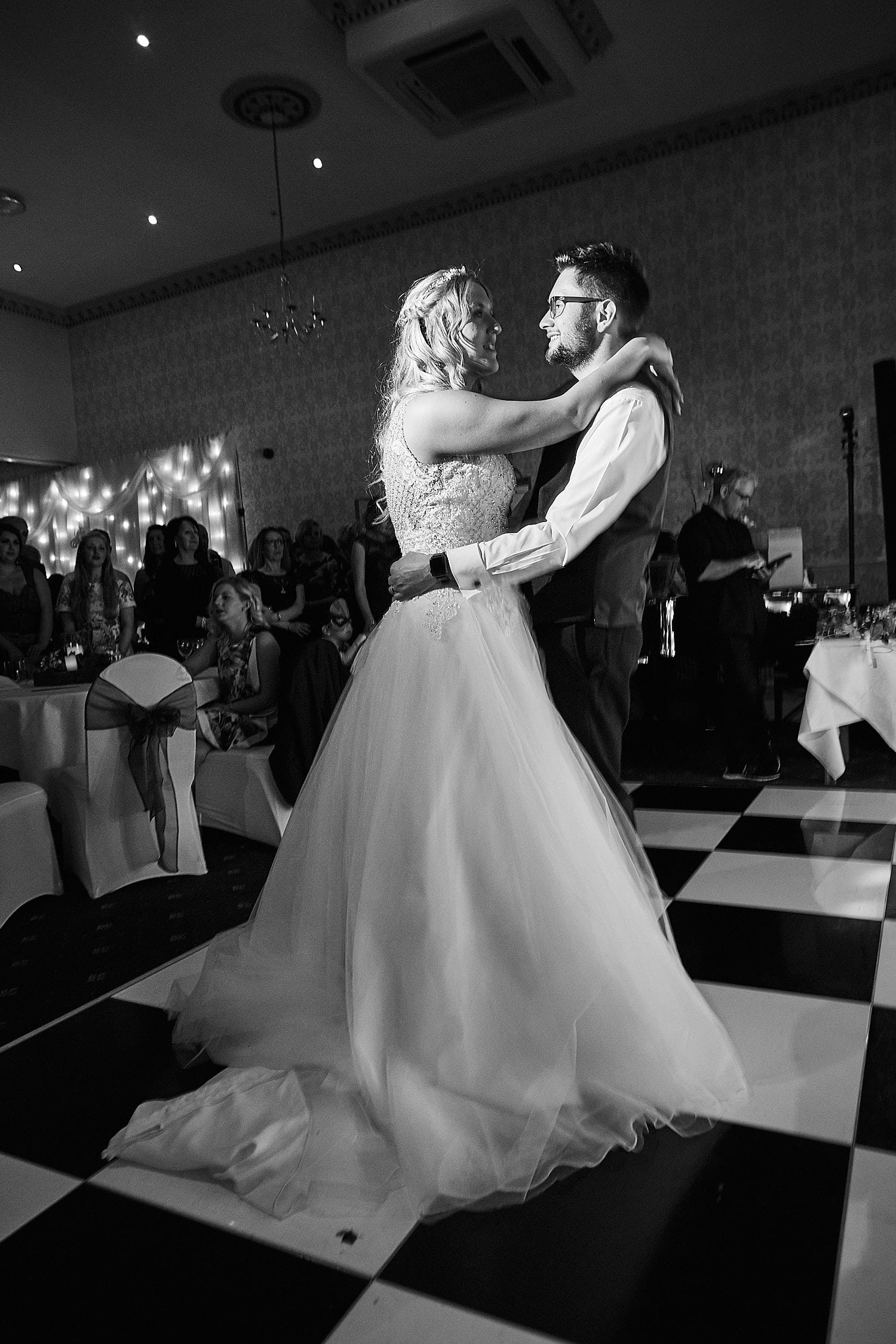 A bride and groom share their first dance on their wedding day