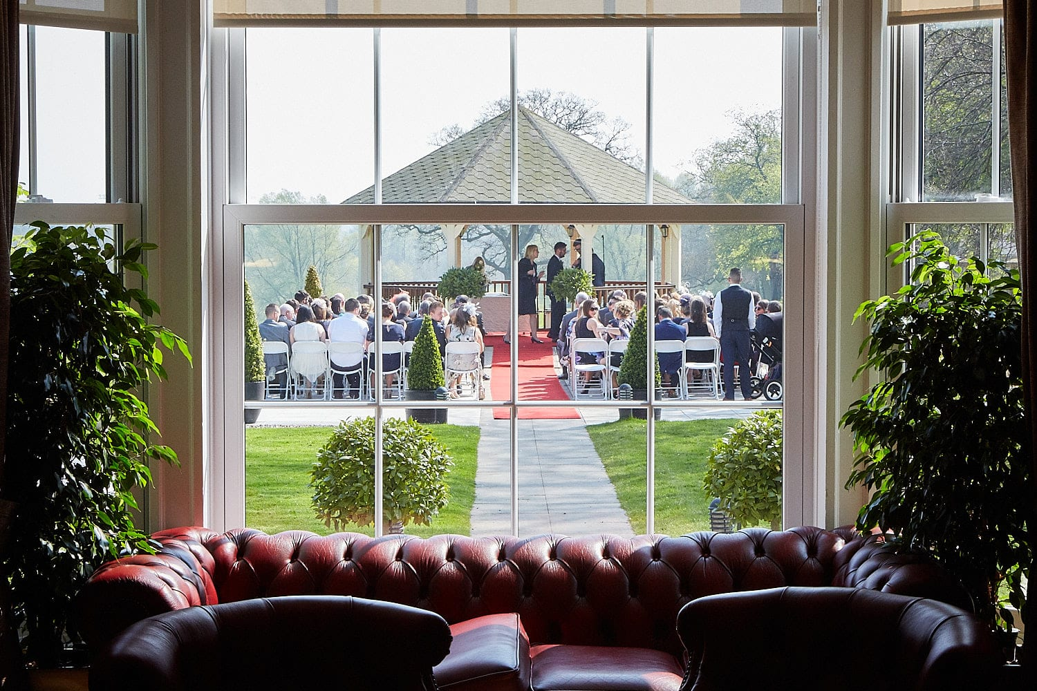 The wedding guests wait outdoors and Kenwick Park, Louth for the arrival of the bride.
