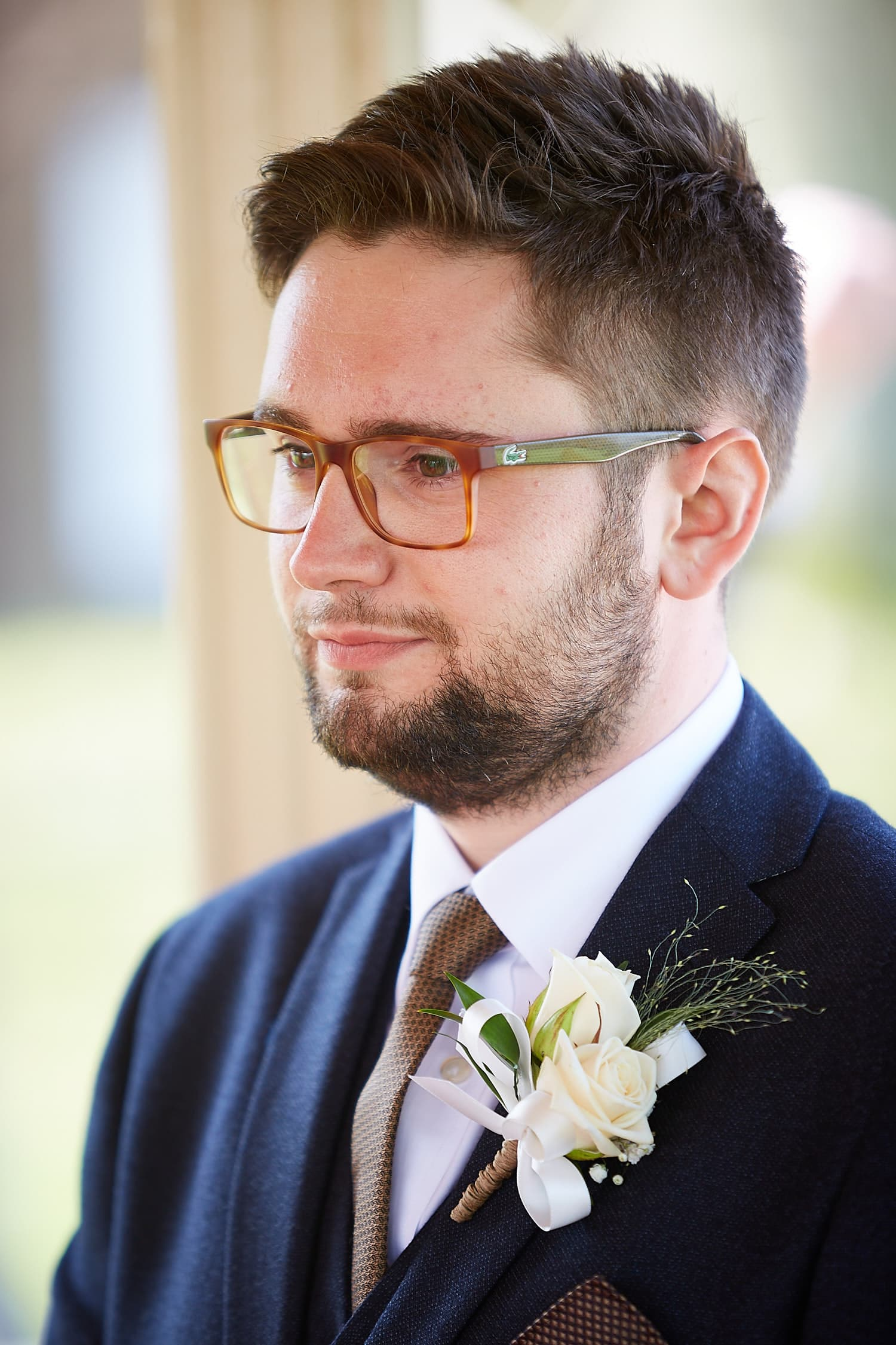 A nervous groom waiting for his bride to walk down the aisle